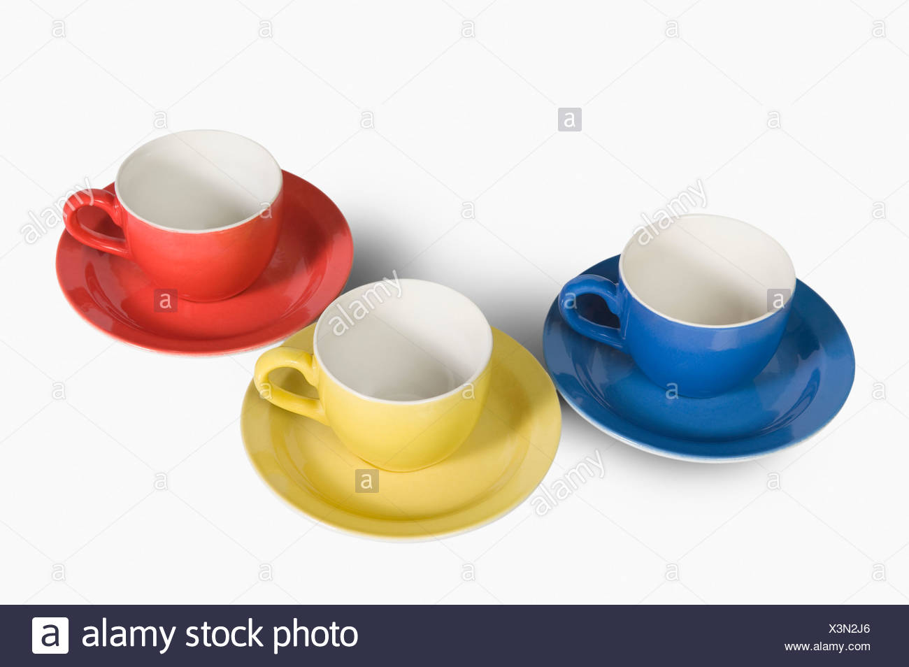 High angle view of colorful tea cups with saucers - Stock Image