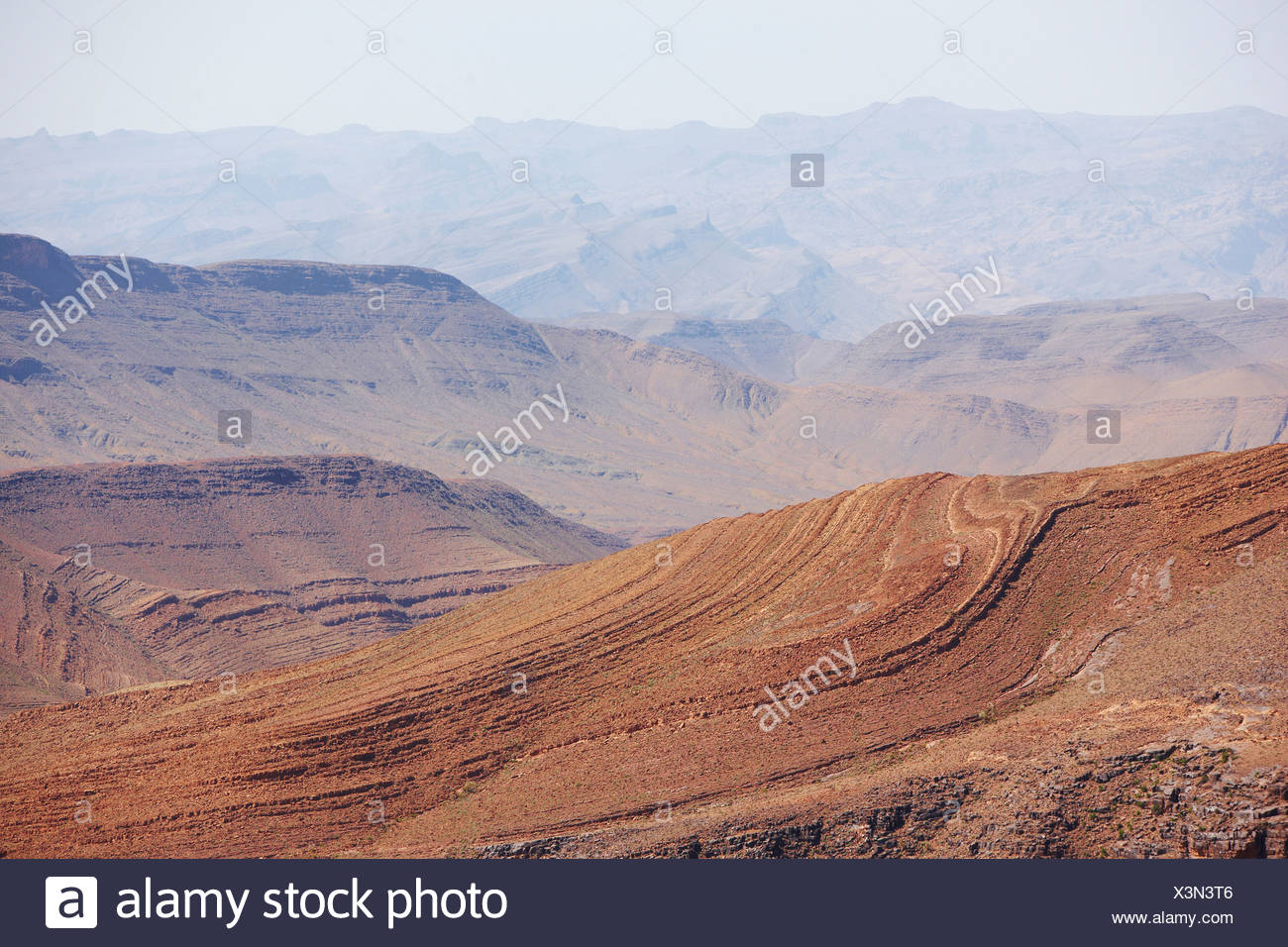 Twisted geologic strata of the Atlas Mountains, Morocco - Stock Image