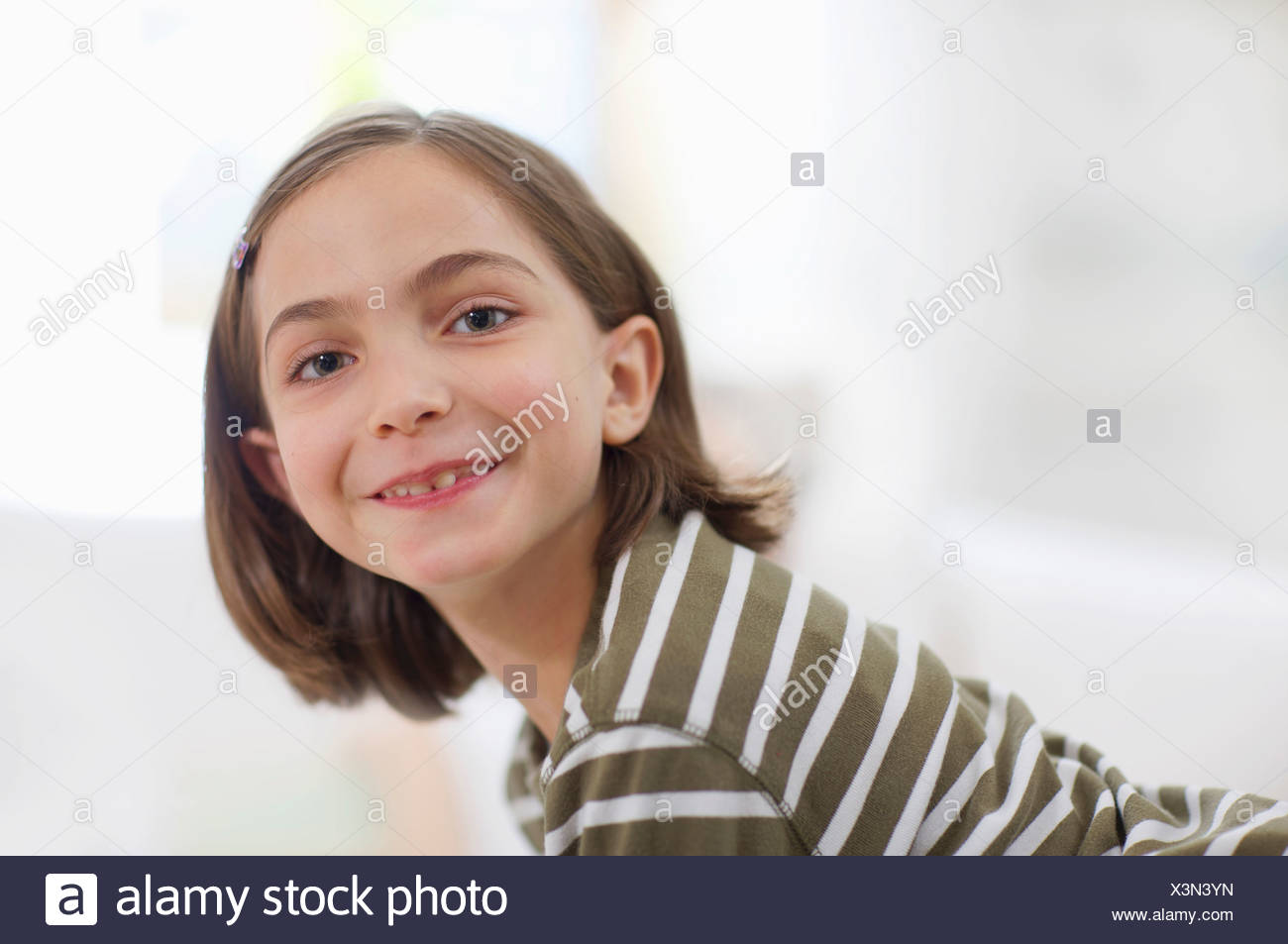 little girl smiling all over the face - Stock Image