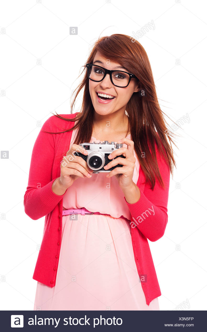 Excited woman holding in hands old camera Debica, Poland Stock Photo