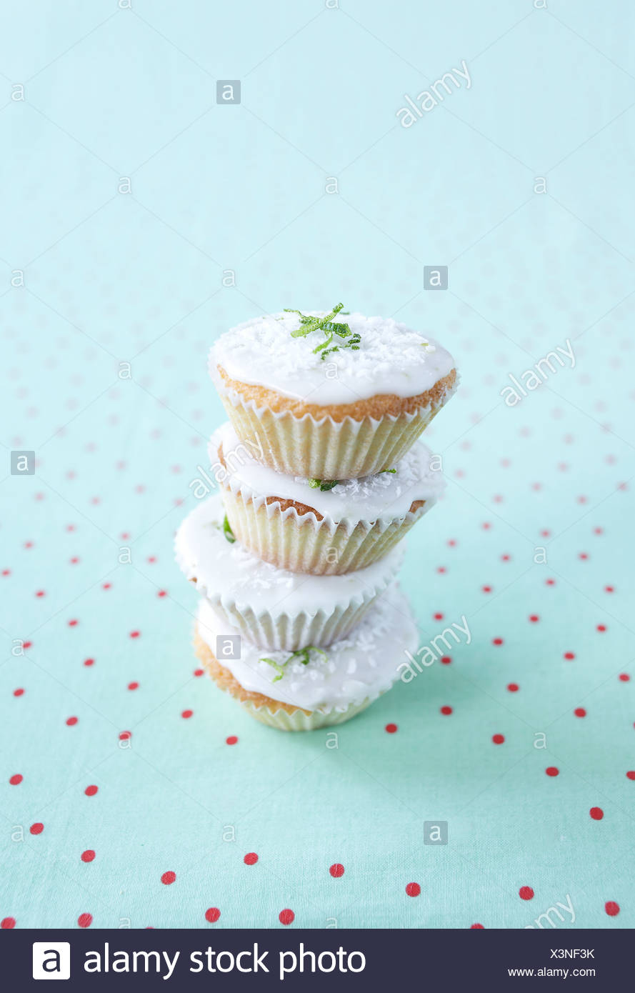 Lime and coconut cupcakes, close-up - Stock Image