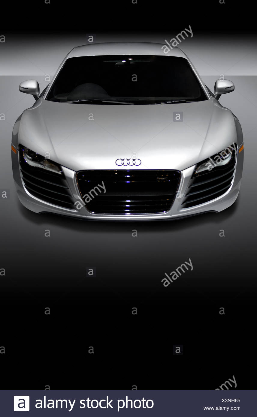 gray metallic audi r8 is a mid-engined german sports car isolated on