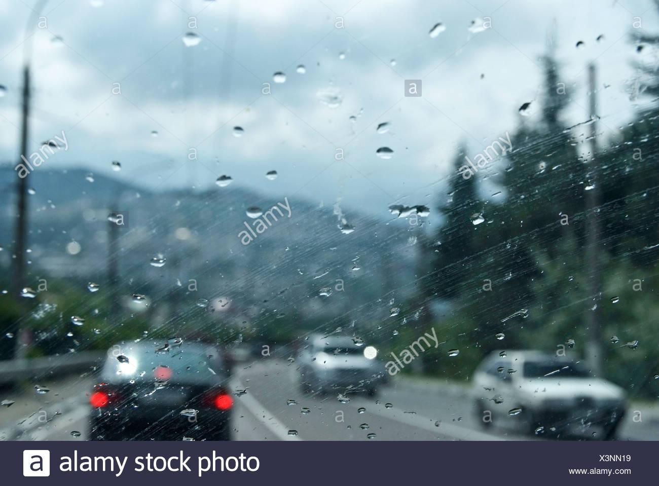Aluschta, Crimea, Ukraine, rain drops, wind shield, car - Stock Image