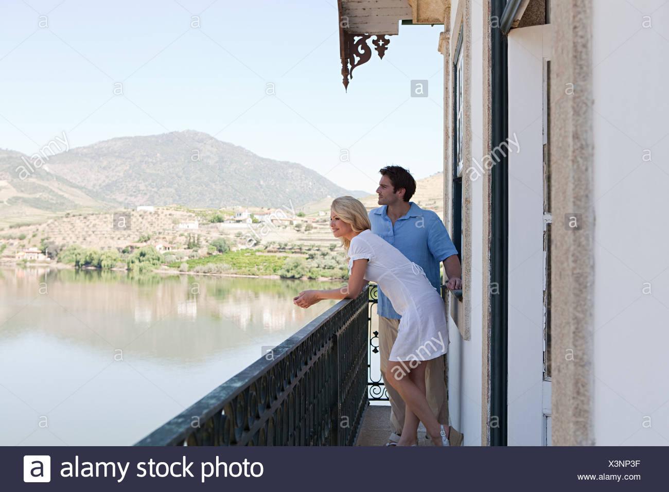 Couple on balcony overlooking douro river - Stock Image