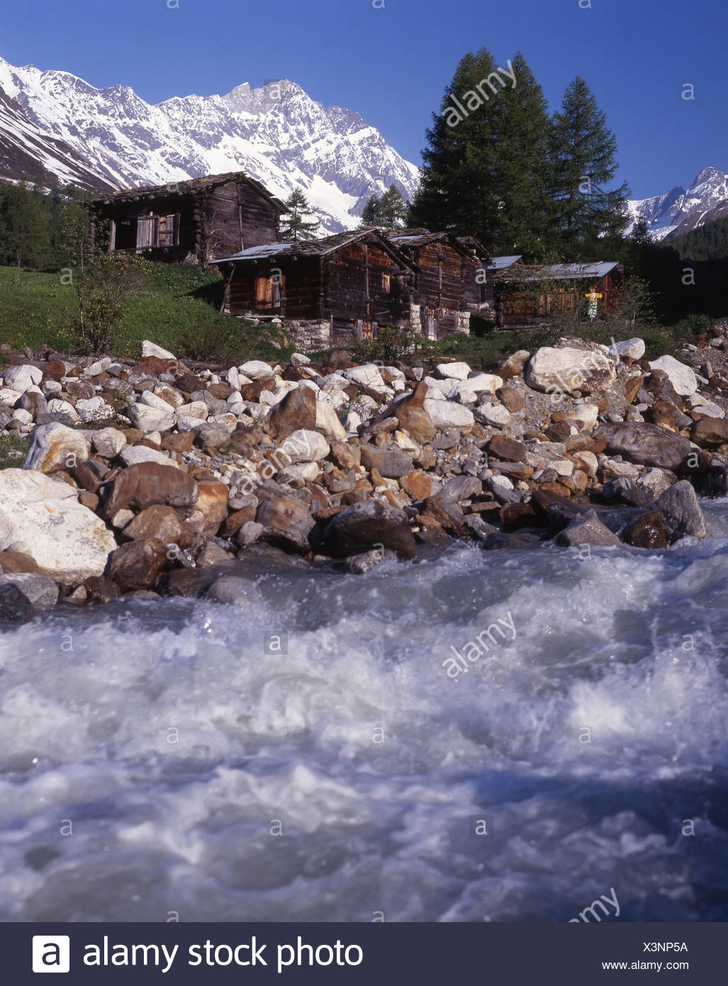 Lotschental Kuhmad hamlet settlement shore brook stream mountain brook Lonza mountains Alps canton Valais - Stock Image