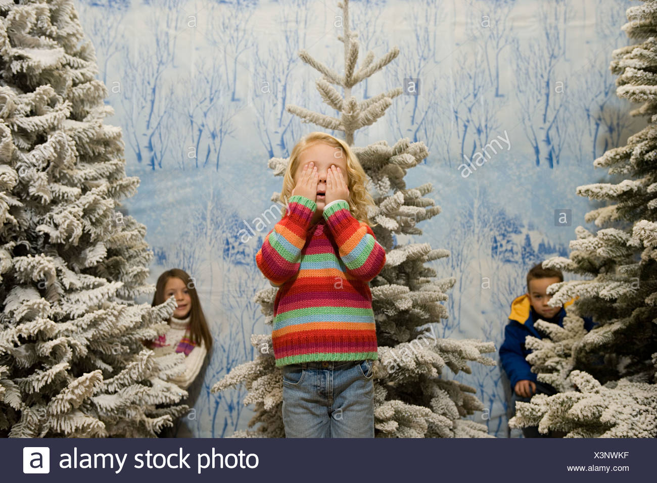 Children playing hide and seek - Stock Image