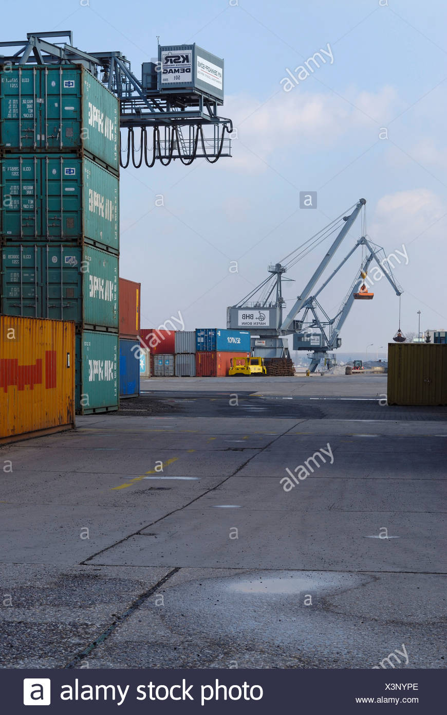 Bonn Harbour, overlooking the terminal, cranes and gantry crane in the back, stacked oversea containers in the front, North Rhi Stock Photo