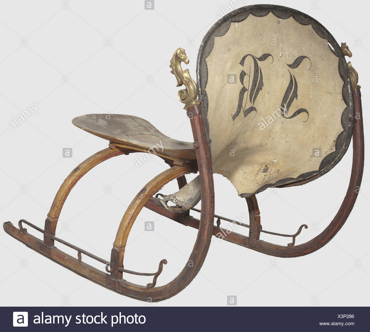 """A German horse-drawn sleigh, mid 19th century Light wooden sleigh with iron fittings. The high curved runners are crowned with a carved horse's head in full relief. Leather harness painted in colour with the monogram """"JK"""". Wooden seat. Height 109 cm. Length 132 cm, historic, historical, 19th century, hunt, hunts, hunting, utensil, piece of equipment, utensils, trophies, object, objects, stills, clipping, clippings, cut out, cut-out, cut-outs, Additional-Rights-Clearences-NA Stock Photo"""