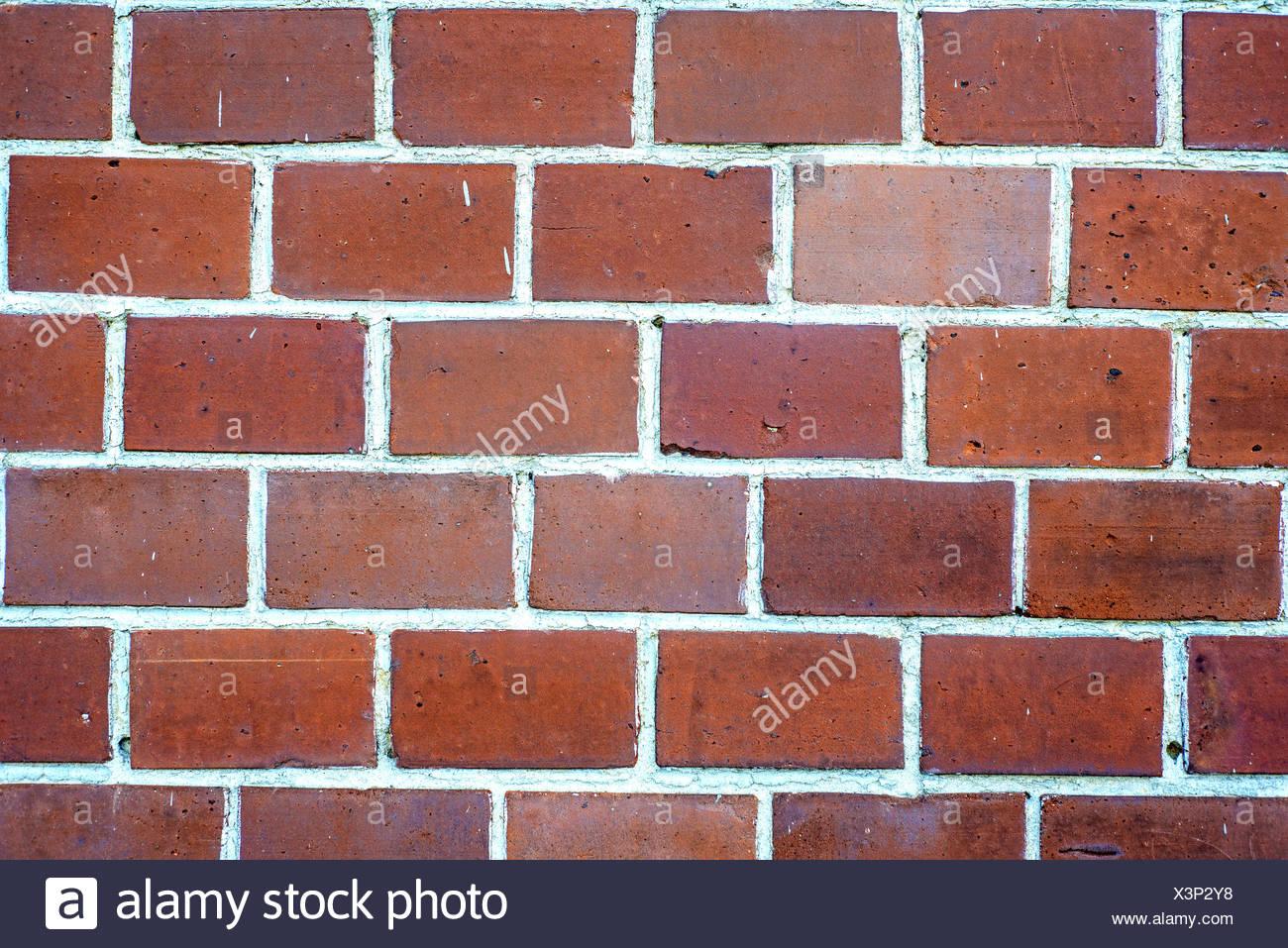 Klinkerwand aus roten Backsteinen. - Stock Image