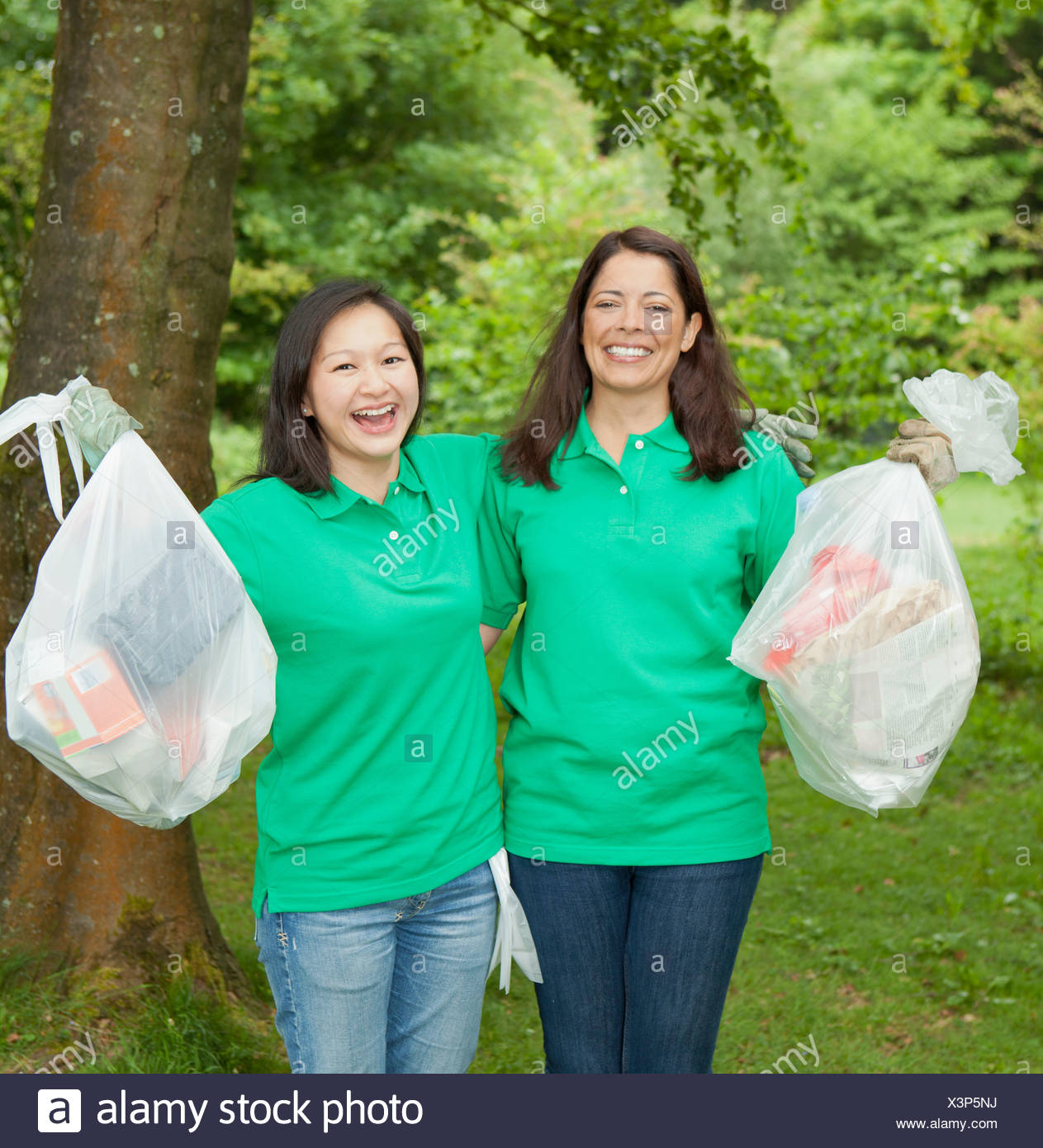 Gardeners picking up trash in park - Stock Image