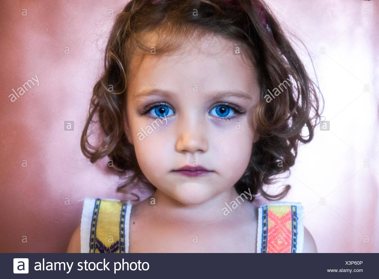Portrait of a girl with blue eyes - Stock Image