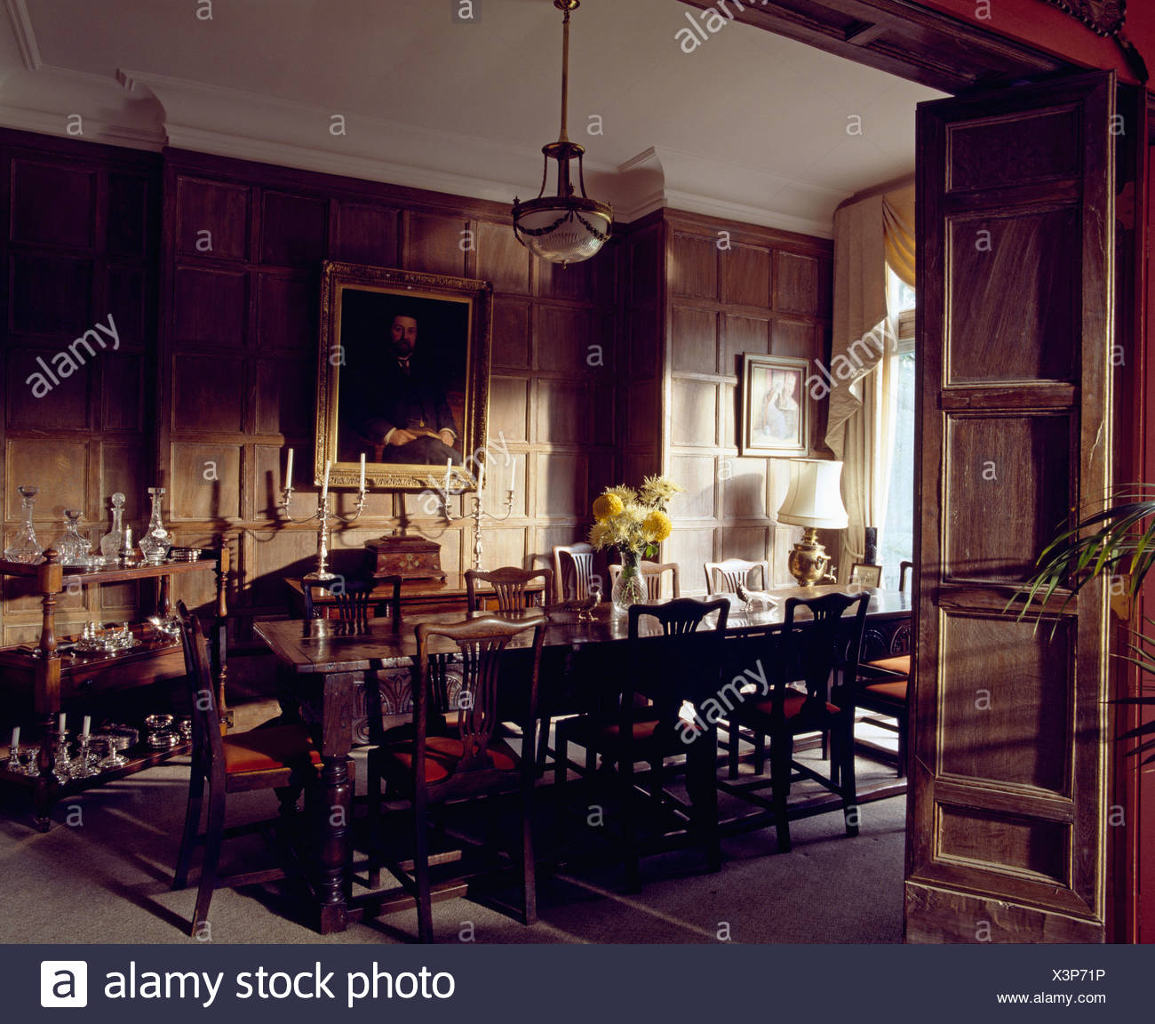 Antique Furniture In Country House Dining Room With Tudor Panelling On The  Walls