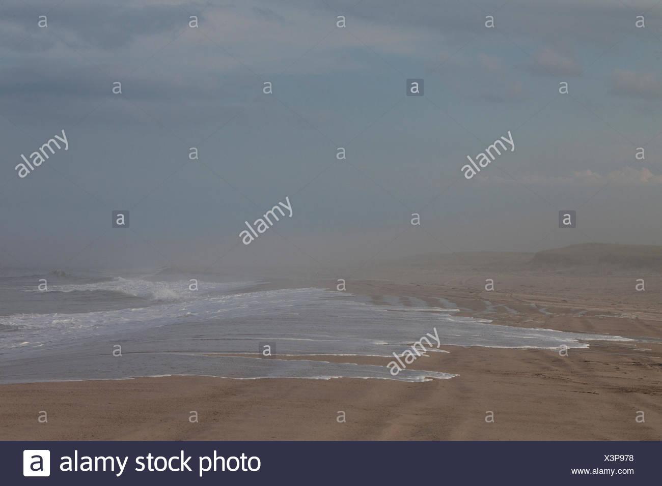 Surf spills onto Nauset Beach. Stock Photo