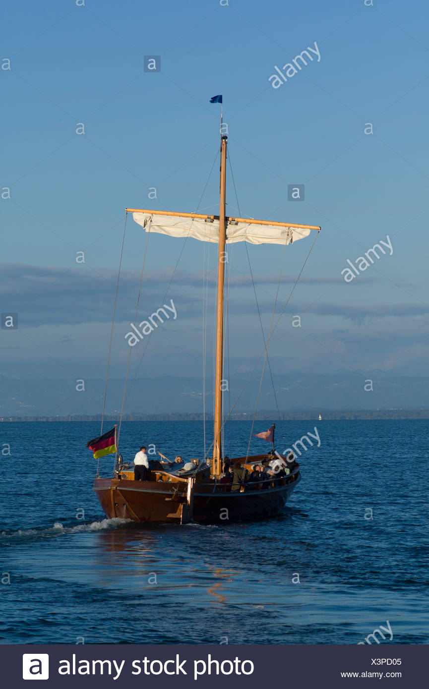 Leadin or Ledine, historic glider, 14th to 20th Century, replica, in the evening light, inland waters, Lake Constance, Germany - Stock Image