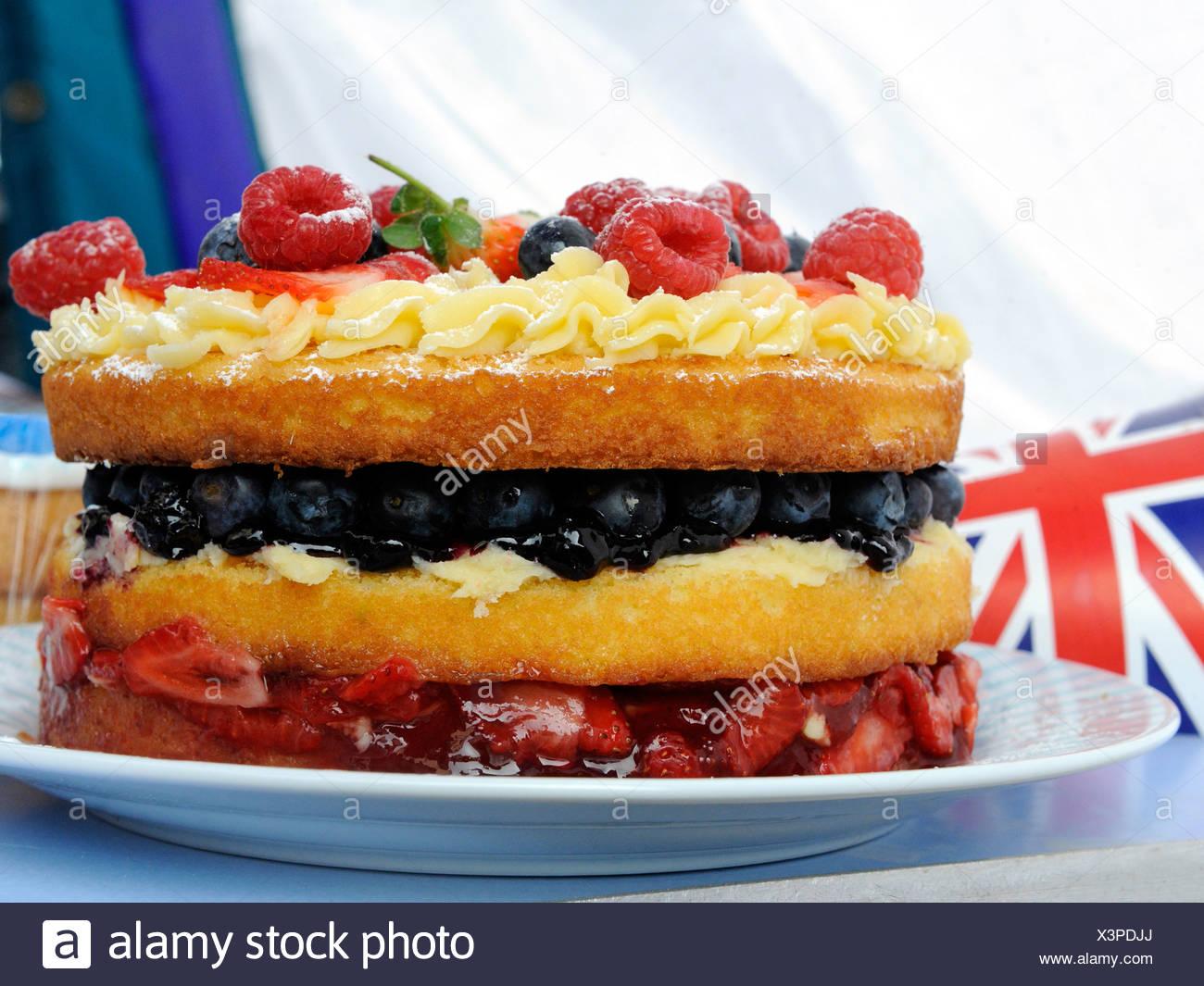A British cake, at a vintage patriotic tea party. - Stock Image