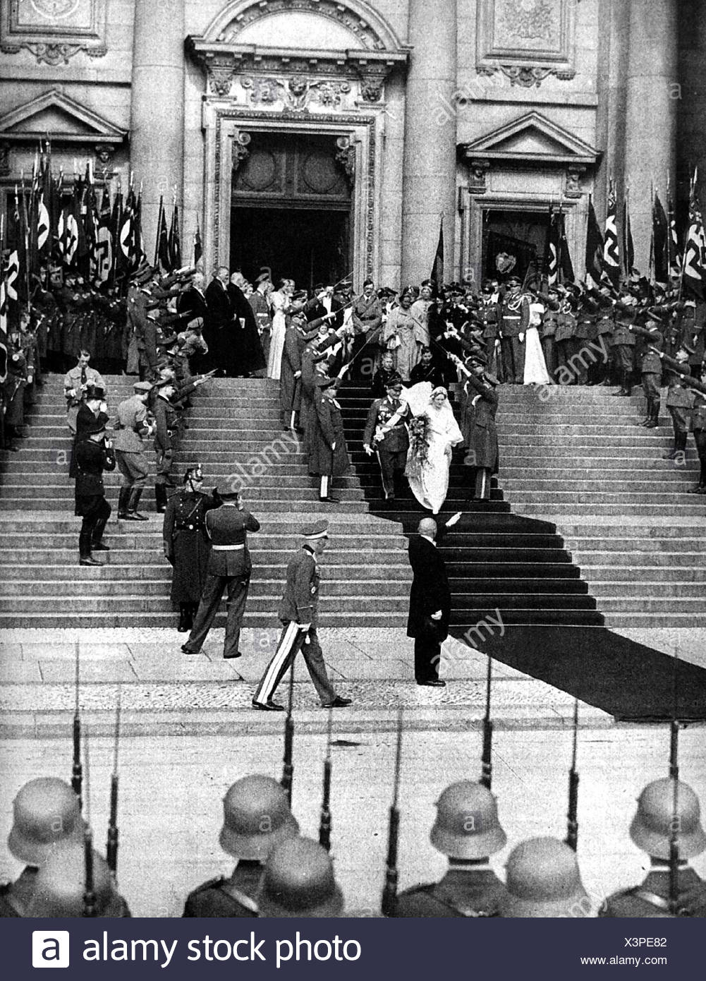 Goering, Hermann, 12.1.1893 - 15.10.1946, Nazi politician, Reich Marshall, scene, his wedding with Emmy Sonnemann, 10.4.1935, the bridal couple is leaving the cathedral, Berlin, Additional-Rights-Clearances-NA - Stock Image