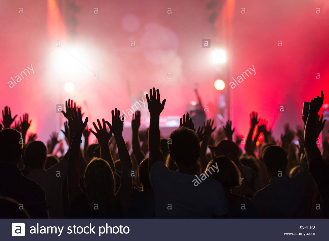 "Concert-goers with their hands up in the air during the concert of the U.S.-American hip hop group ""De La Soul"" performing live Stock Photo"