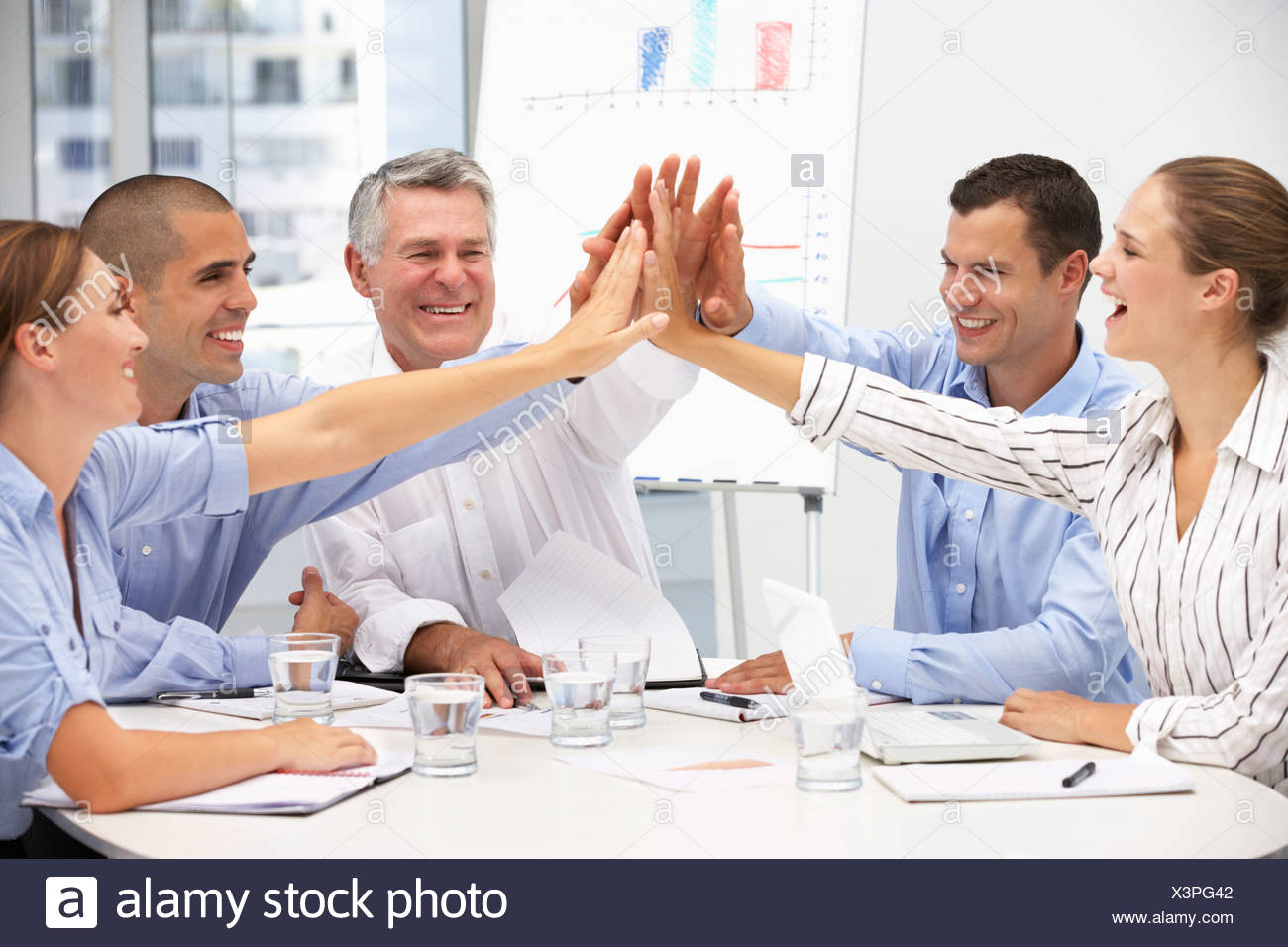 Colleagues in business meeting Stock Photo - Alamy