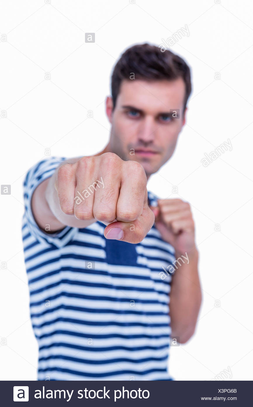 Handsome hipster attacking with his left fist Stock Photo