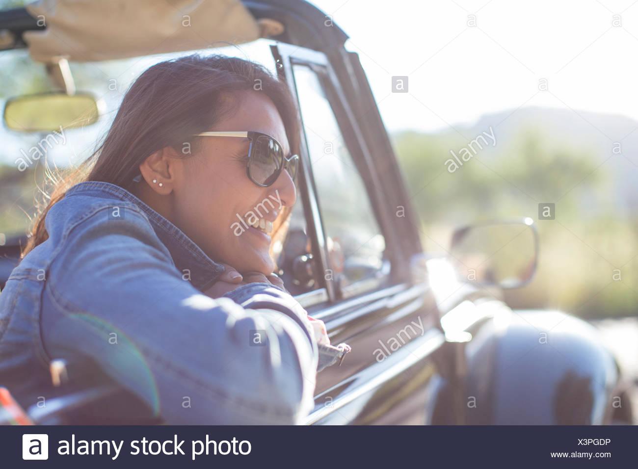 Mature woman in convertible car - Stock Image