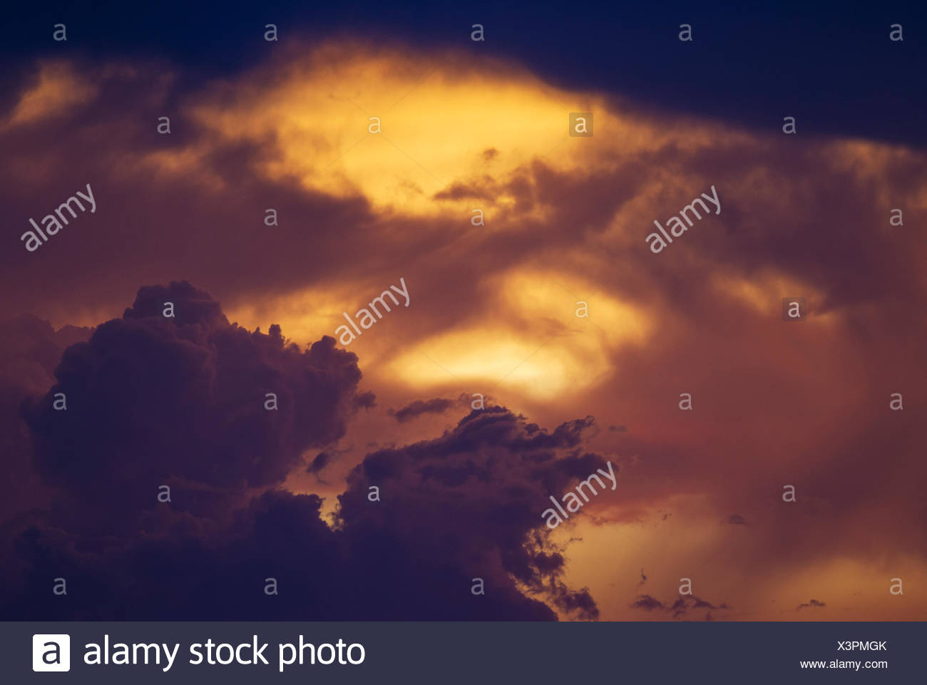 Cumulonimbus clouds in the evening, rainy season, Kalahari Desert, Kgalagadi Transfrontier Park, South Africa - Stock Image