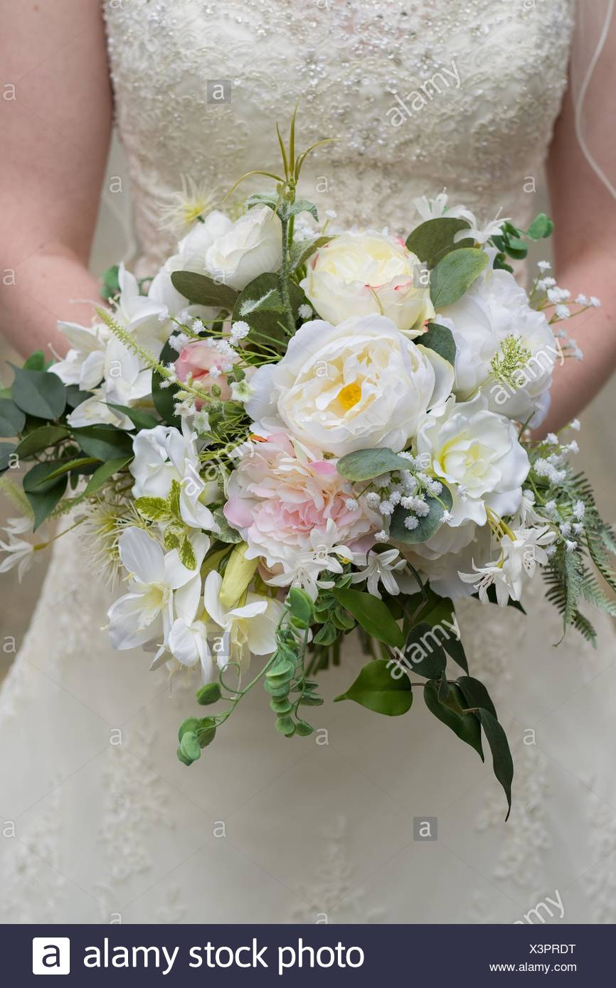 Wedding Bouquet Held By The Bride Made Up Of Fake Flowers But Looks