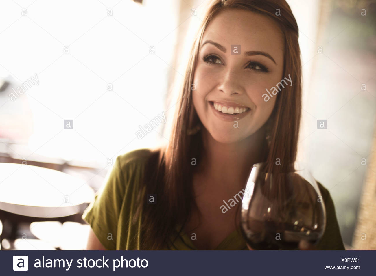 Young businesswoman in wine bar - Stock Image