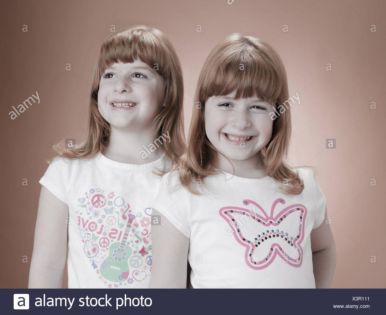 Identical twin girls - Stock Image