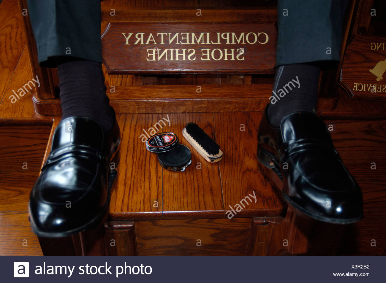black brush care clean cream customer Hotel leather shoes polish services shoes clean shoeshine boys Stock Photo