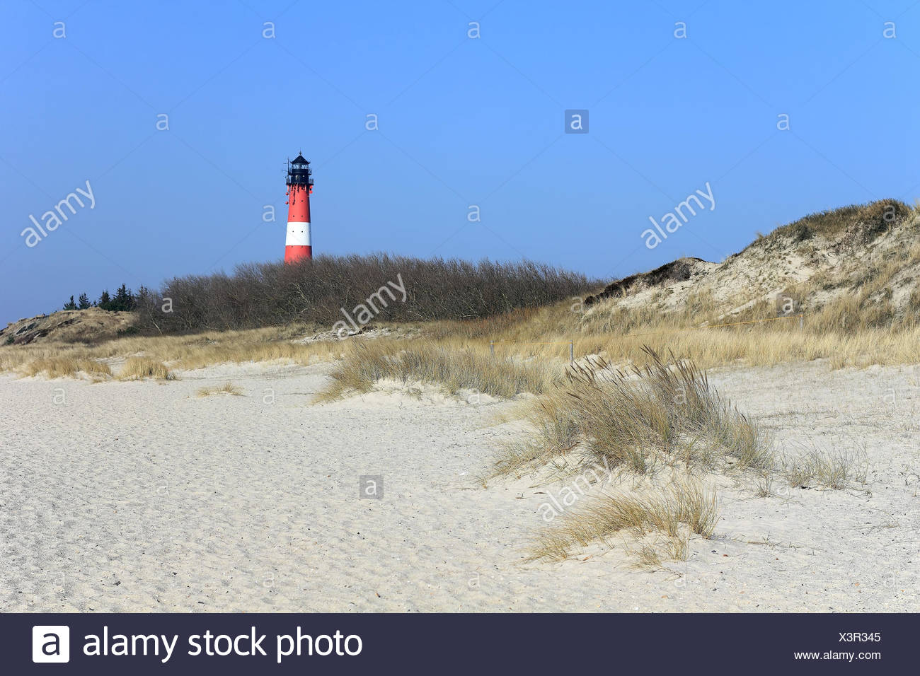 Lighthouse and dunes in South of island of Sylt - Stock Image