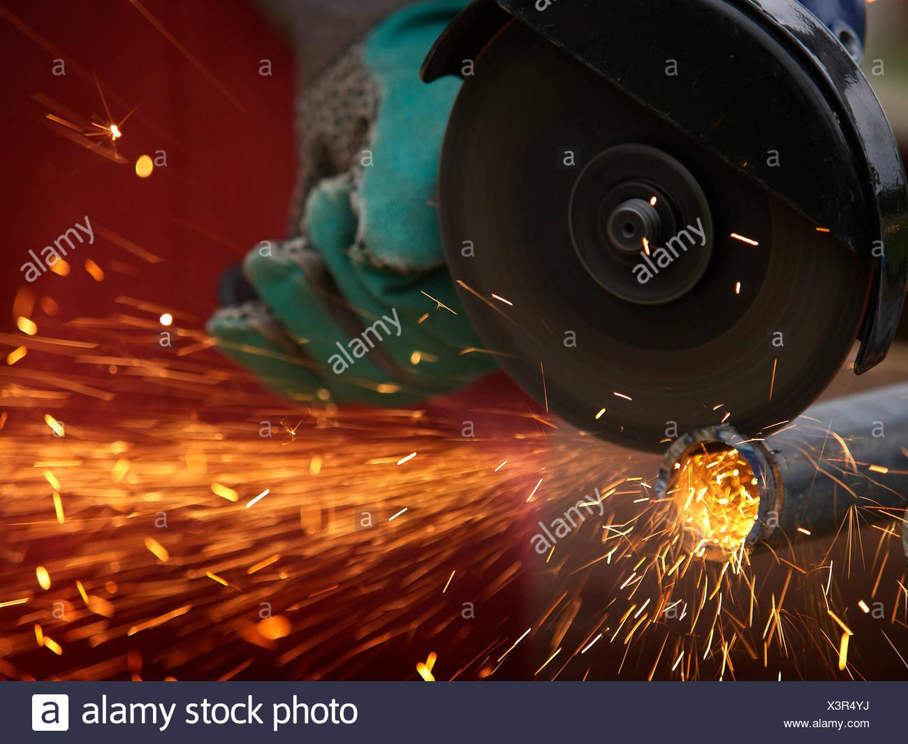 flying sparks,angle grinders,angle grinder - Stock Image
