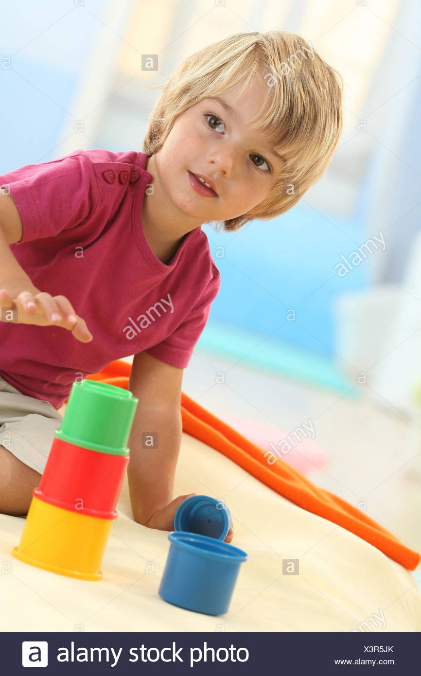Boy, 3 years, toys, tower, build, portrait, - Stock Image