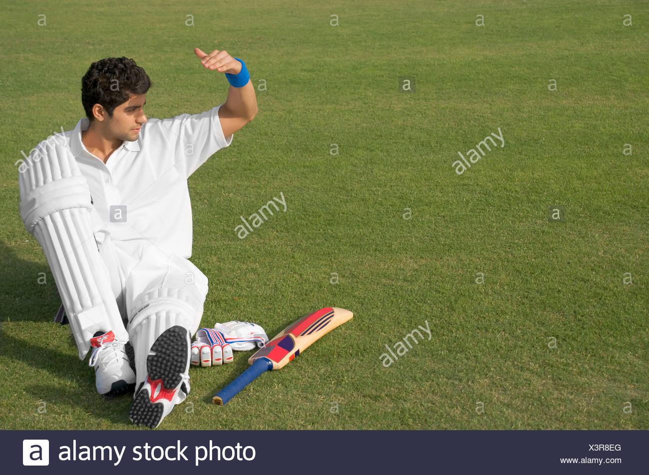 Batsman relaxing - Stock Image