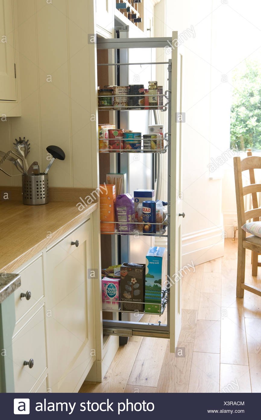 Pull out storage unit in country kitchen Stock Photo ...