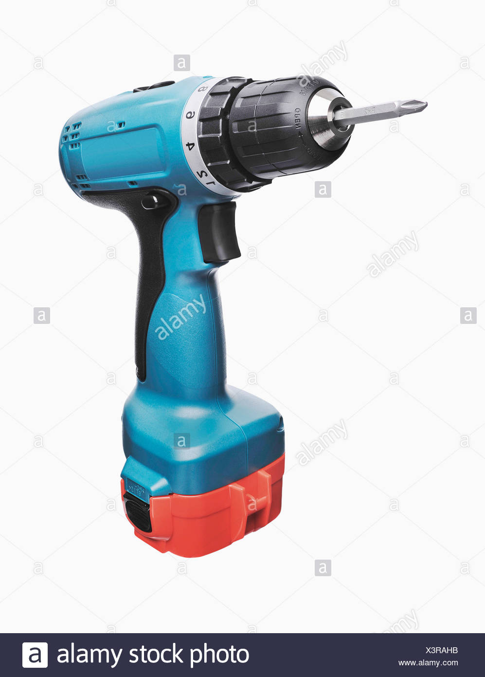 Cordless screwdriver against white background, close up - Stock Image