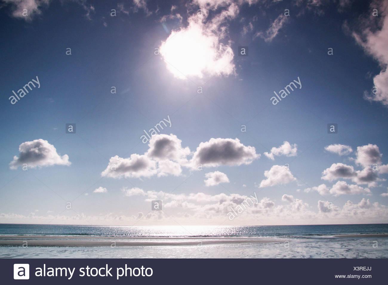 sun shining over the sea - Stock Image