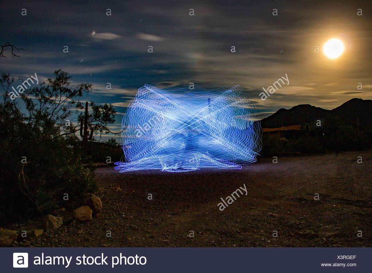 Abstract Lights On Landscape At Sunset - Stock Image