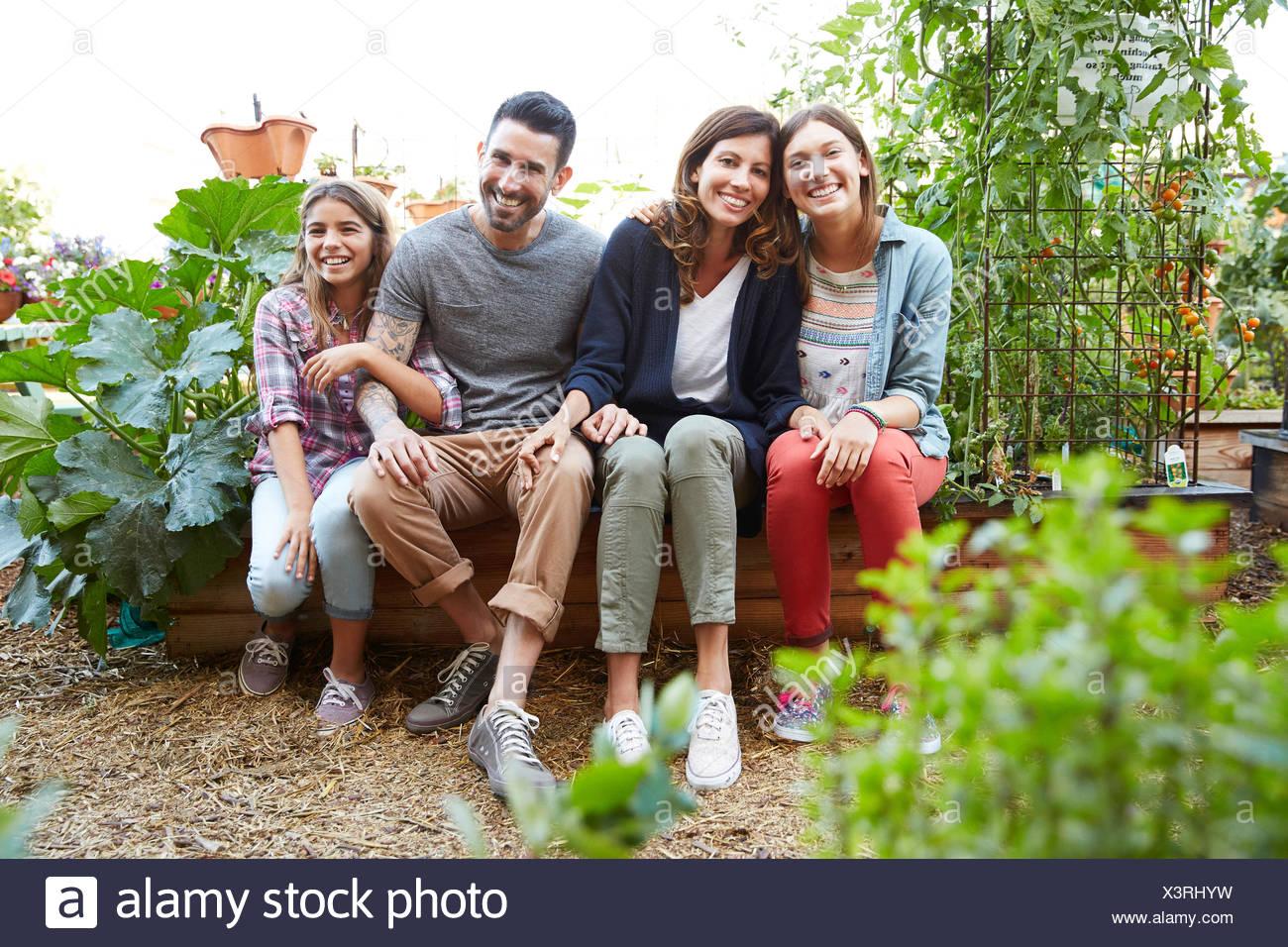 Portrait smiling Latina family in vegetable garden Stock Photo