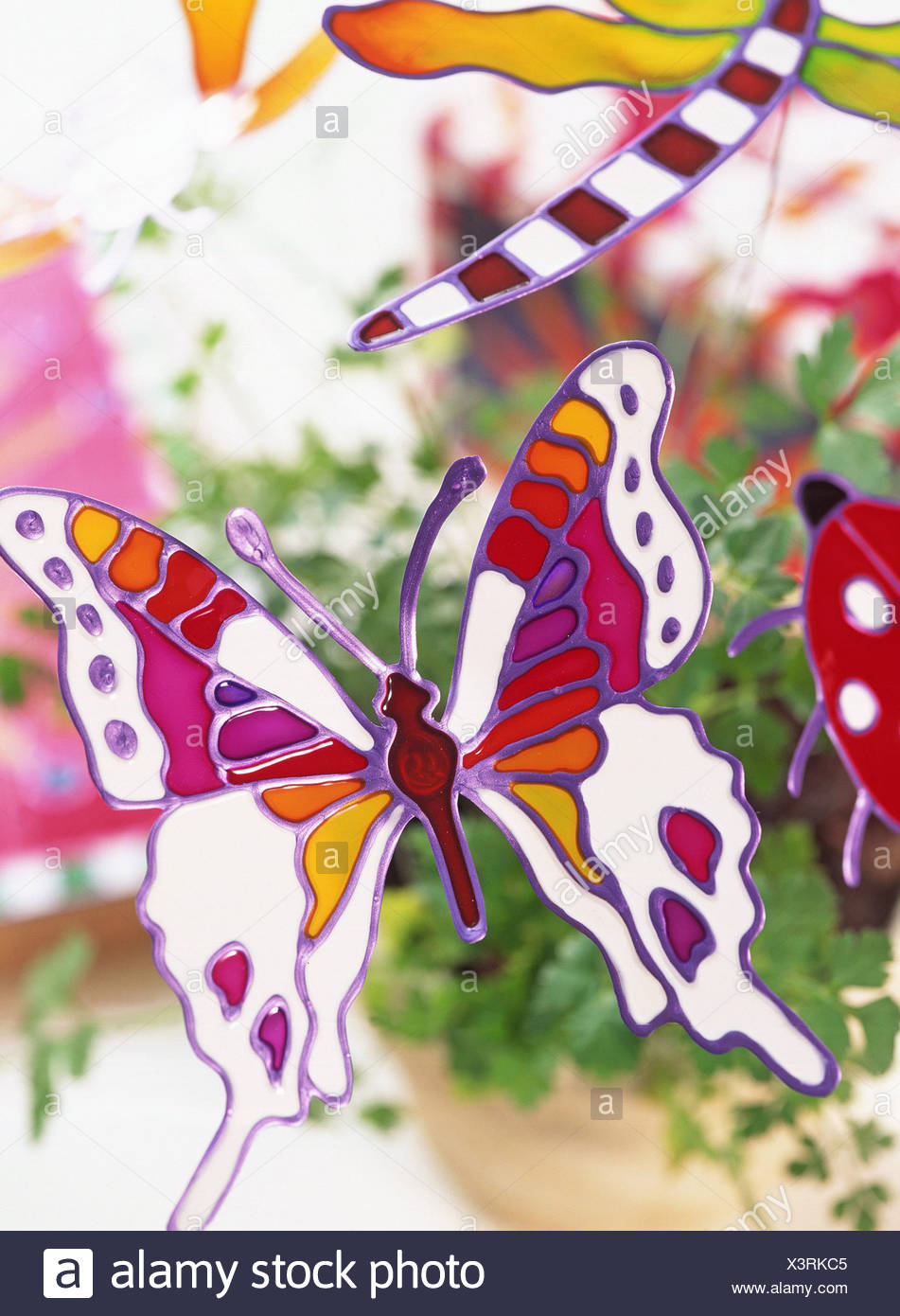 Glass glaze creations Turn ordinary articles into works of art colourful glass glaze Butterfly design pot plant decoration - Stock Image