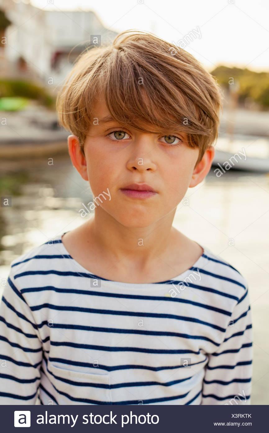 Spain, Menorca, Portrait of smiling boy (6-7) - Stock Image