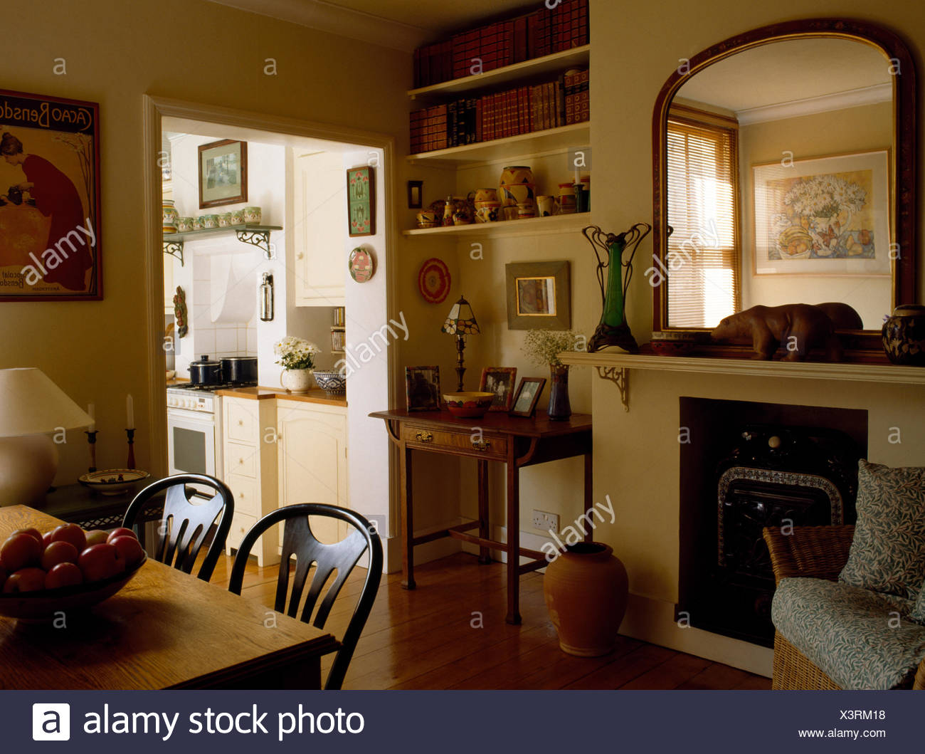 Victorian Mirror Above Fireplace In Nineties Dining Room With Doorway To Kitchen Stock Photo Alamy