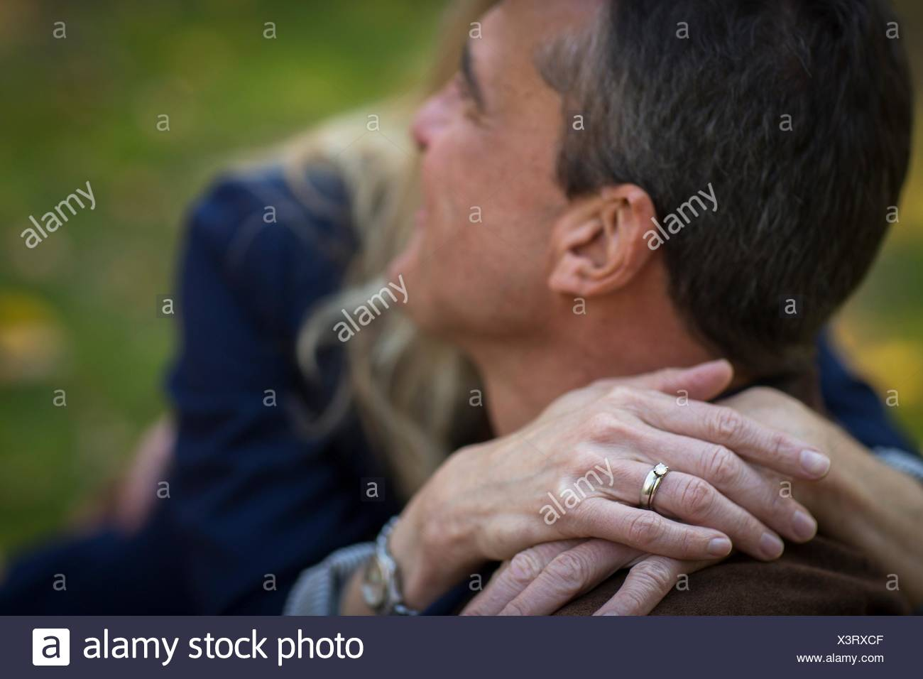 Close up of romantic mature couple in garden - Stock Image