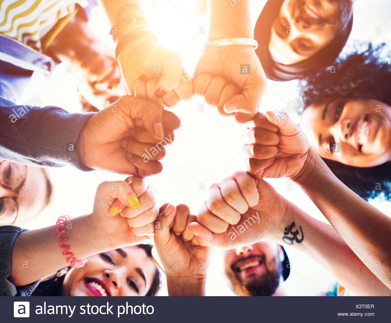 Friends Fist Together Circle Teamwork Concept - Stock Image