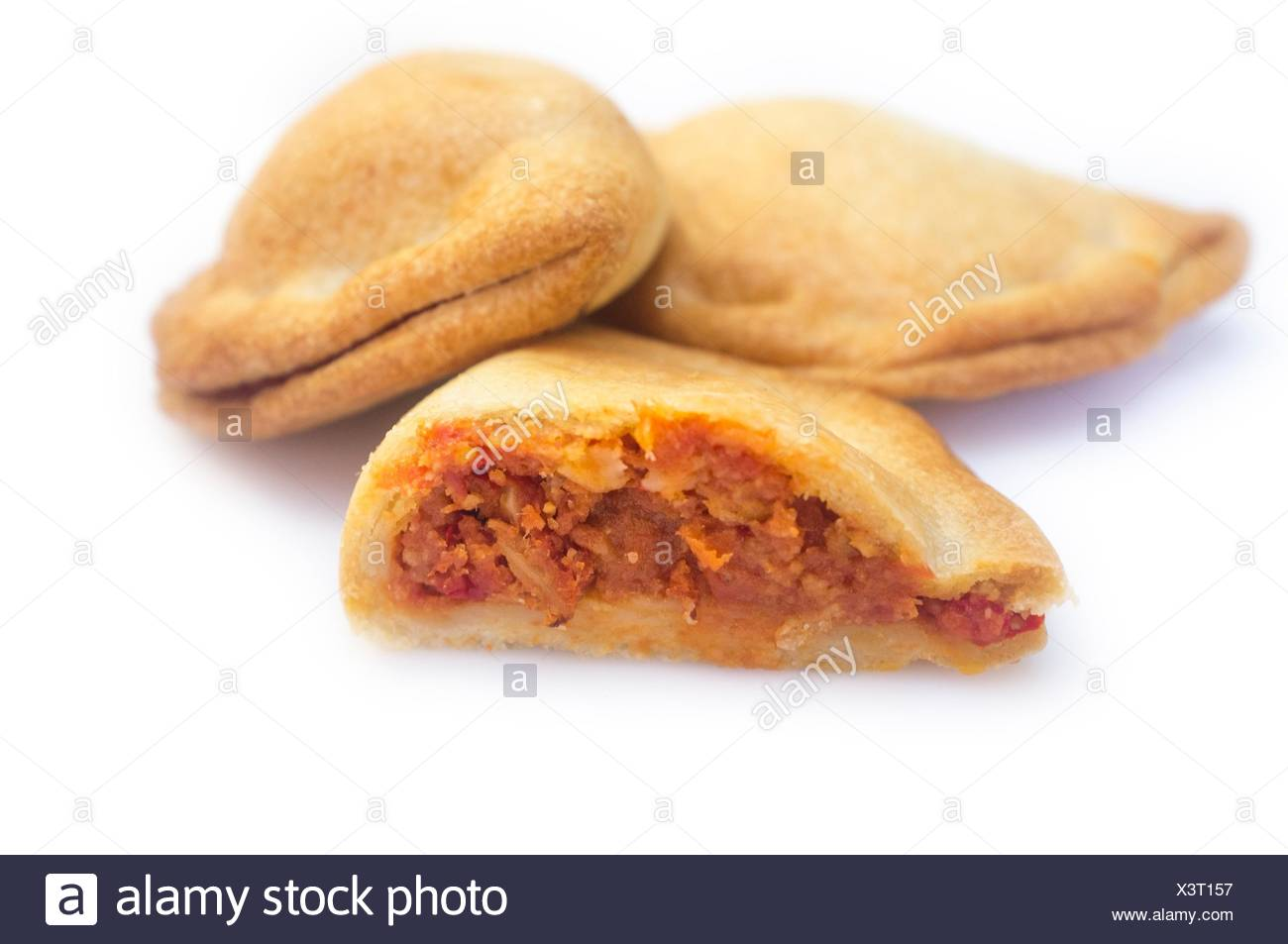 Typical spanish empanadillas or tuna small turnover. Isolated over white background. - Stock Image
