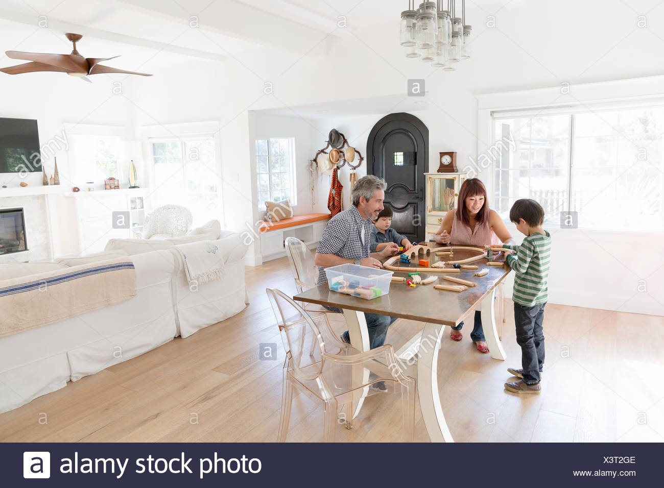 Family playing with wood train set at dining table - Stock Image & Boys Playing With Train Set Stock Photos u0026 Boys Playing With Train ...