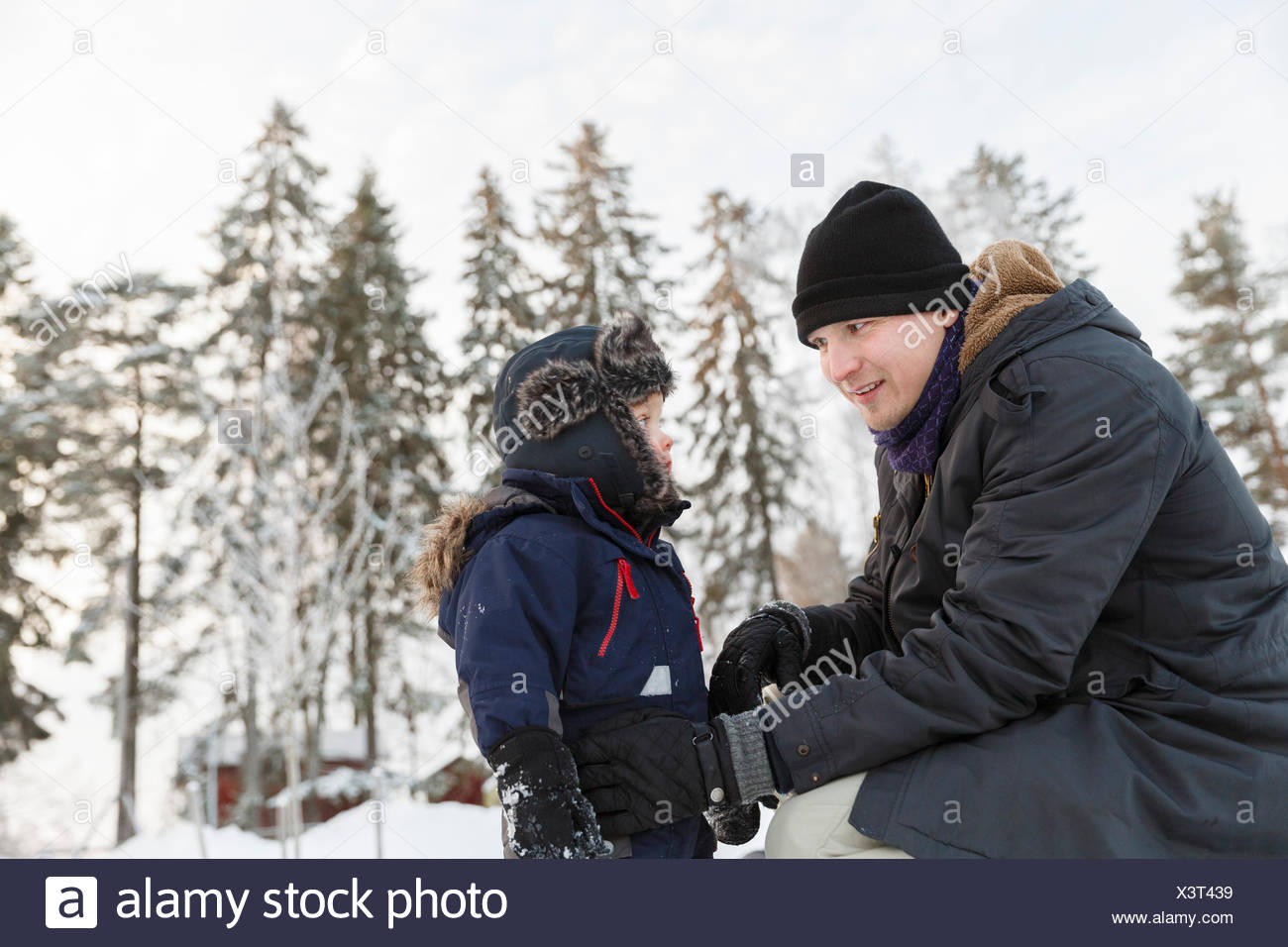Father and son wearing hats during winter Stock Photo
