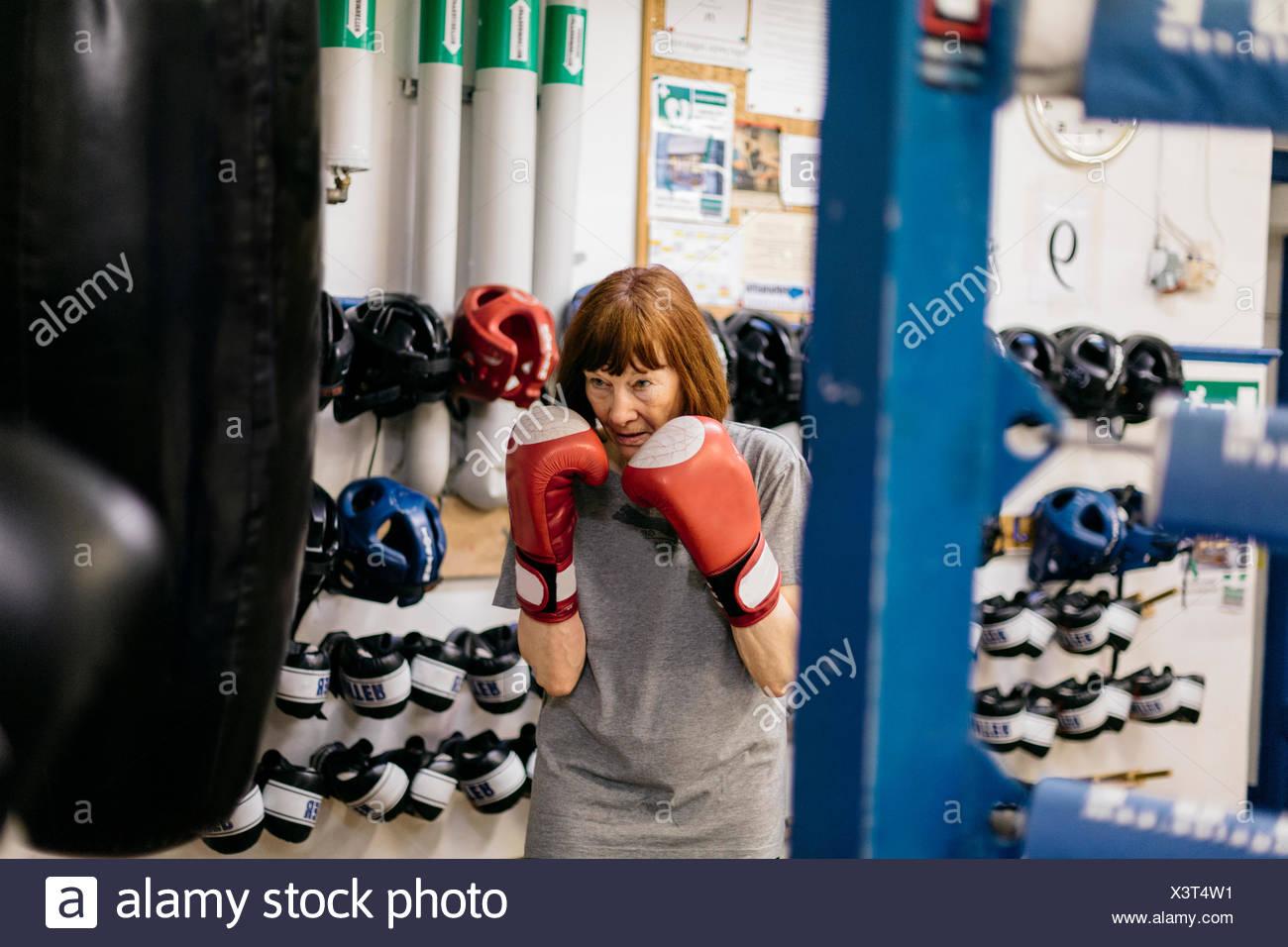 Senior woman at boxing training Stock Photo