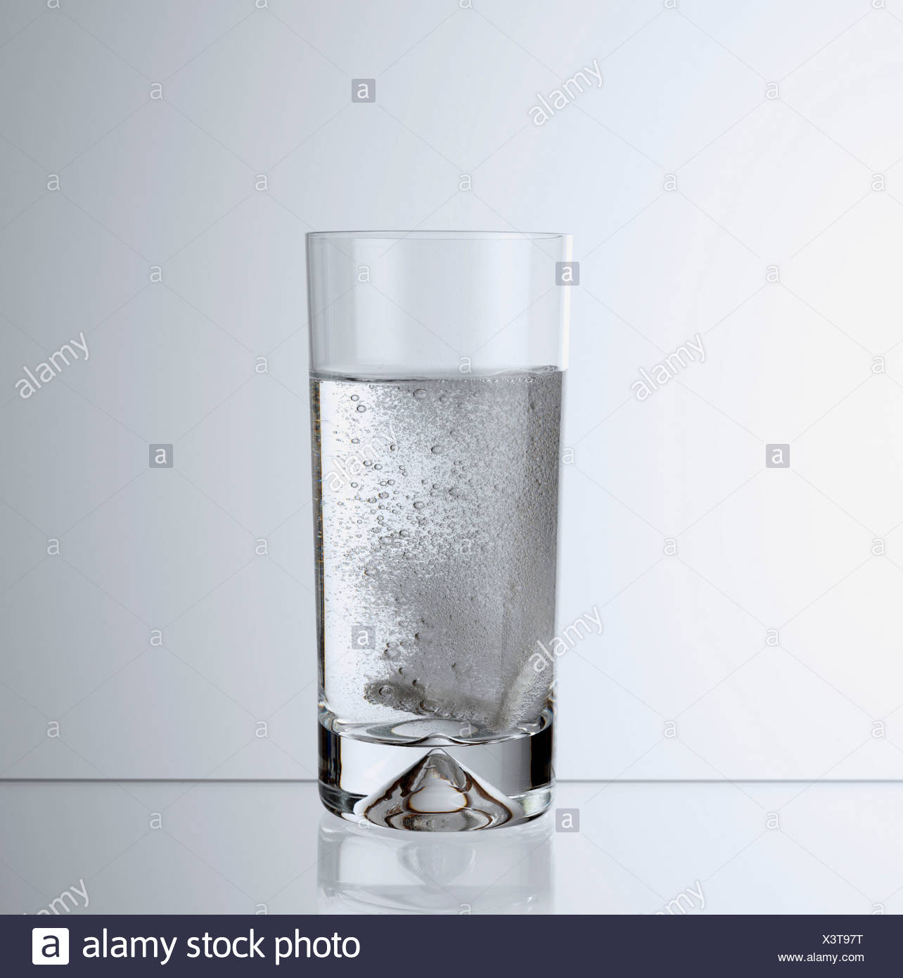 Glass of carbonated beverage - Stock Image