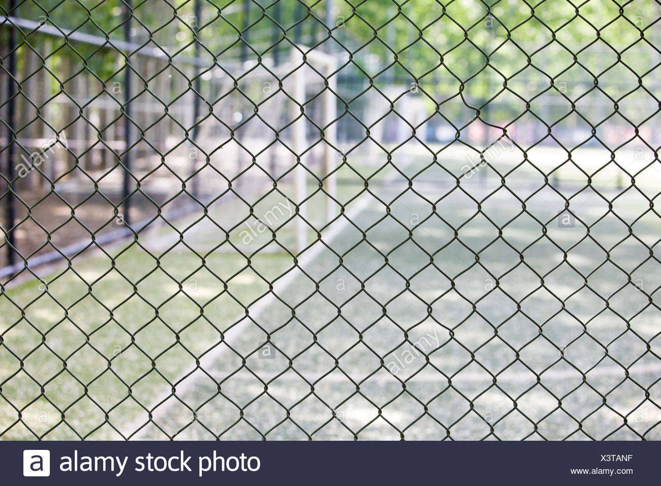 Soccer field behind fence Stock Photo: 277745147 - Alamy
