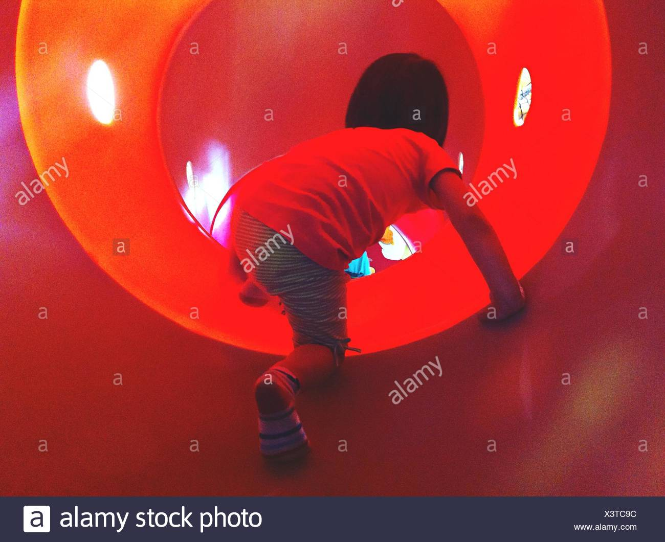 Boy In Tunnel At Playground - Stock Image